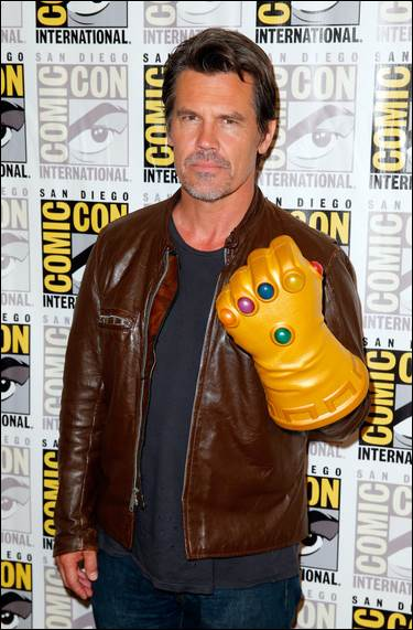 Thanos (Josh Brolin) isn't smiling as he shows off the Infinity Gauntlet