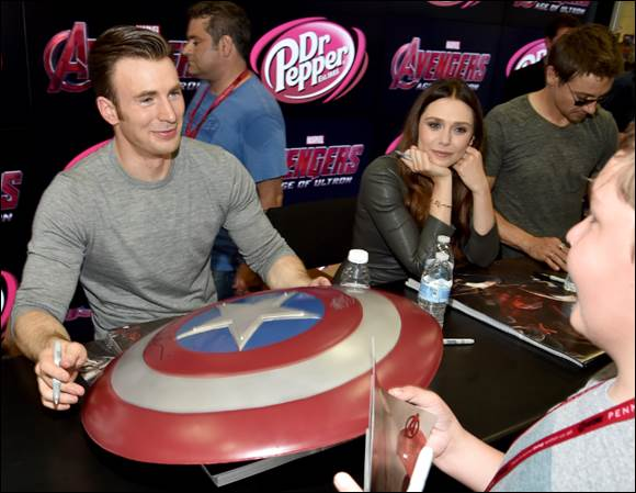Captain America (Chris Evans) testing out the vibranium on the shield.